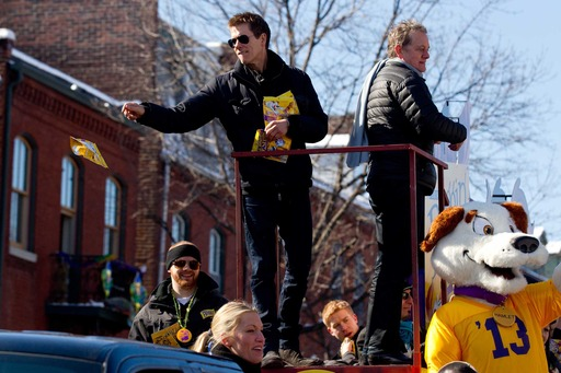 Kevin and Michael Bacon of The Bacon Brothers toss Beggin' to the parade crowd at the 20th annual Beggin'® Pet Parade, Sunday, Feb. 3, 2013 in St. Louis. Image provided by Purina®