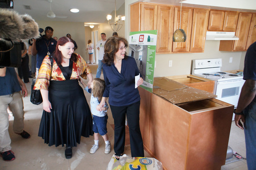 Linda Lipofsky sees her new kitchen after Grip-Rite and Rebuilding Together partnered to rebuild her house and turn it back into a home.