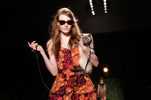 Purina ONE and Tracy Reese put a leash-trained cat center stage to highlight the True Nature of cats during the Tracy Reese Fall 2013 collection show at Fashion Week, Sunday, Feb. 10, 2013 in New York. (Jason DeCrow/Invision for Purina ONE/AP Images)