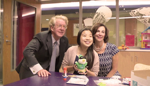 Aflac CEO Dan Amos and Kathelen Amos with newest Aflac Duck designer Michelle Nguyen