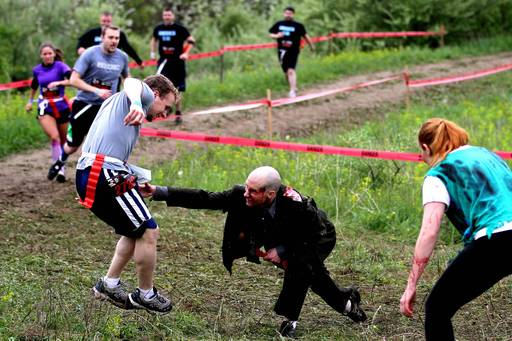 A runner comes head-to-head with a member of the undead while trying to protect his remaining flags.