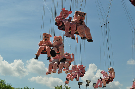 "History was made at Six Flags Over Georgia today with the opening of the park's newest and tallest attraction – SkyScreamer. This 24-story extreme swing ride put the age old expression ""when pigs fly"" to rest."