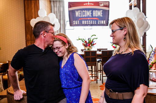 Army Sergeant First Class Russell Zink thanks daughter Jane Zink and wife Amy Zink for conspiring with Homewood Suites on surprise family reunion.