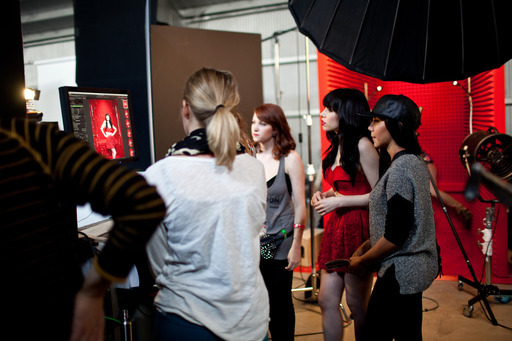 Carly Rae checking out a shot from her güd Red Ruby Groovy photo shoot