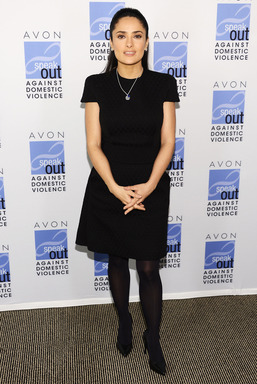 Avon Foundation for Women Ambassador Salma Hayek Pinault wears the new Avon Empowerment Charm Necklace to raise funds to end domestic violence in honor of International Women's Day.