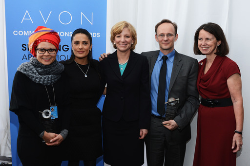 Salma Hayek Pinault and Avon CEO Sheri McCoy at the UN with 2nd Avon Communications Awards winners, recognized for their work at bringing attention to the need to end violence