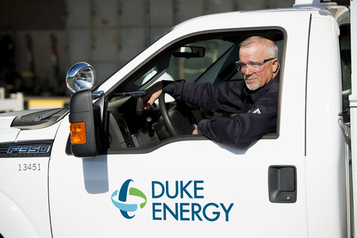 Line technician George Flowe in a Duke Energy truck with the new logo.
