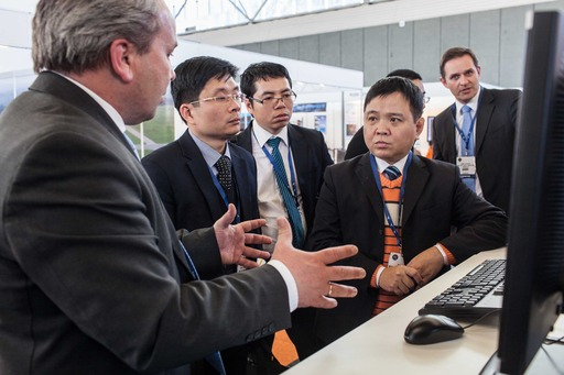 Exhibitor demonstrate services to visitors from China at ATC Global 2013