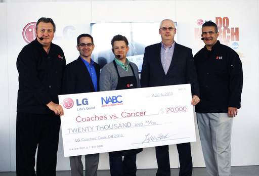 LG Electronics donates $20,000 to Coaches vs. Cancer in the name of coach Bob Huggins.