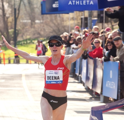 U.S. Olympian Deena Kastor crosses the finish line in 1:13:25.05 to win the 10th Anniversary More Magazine/Fitness Magazine Women's Half-Marathon on April 14, 2013. Kastor broke the event record and tied the course record.