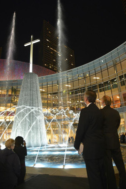 First Baptist Dallas Pastor Robert Jeffress listens as a custom rendition of a popular hymn accompanies the inaugural lighting on the Fountain Plaza of the new $130 million campus.