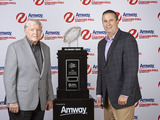 (L-R) Grant Teaff, American Football Coaches Association (AFCA) Exec. Director and Jim Ayres, Managing Director of Amway N. America, unveil Amway?s new landmark deal with USA TODAY Sports Media Group.