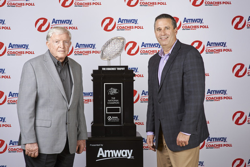 (L-R) Grant Teaff, American Football Coaches Association (AFCA) Exec. Director and Jim Ayres, Managing Director of Amway N. America, unveil Amway's new landmark deal with USA TODAY Sports Media Group.