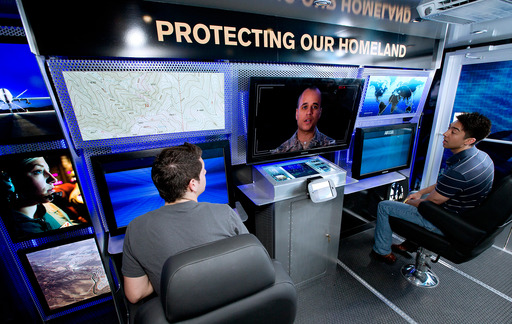Visitors to the Air National Guard Mobile Experience hone their surveillance skills with the reconnaissance challenge inside the mission command center, which replicates a real mission Airmen could execute on drill weekend.
