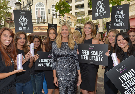 Heidi Klum and women at L.A.'s the Grove commit to work at the right end of hair with CLEAR SCALP & HAIR BEAUTY THERAPY. 99% of hair's strength and beauty comes from the scalp.