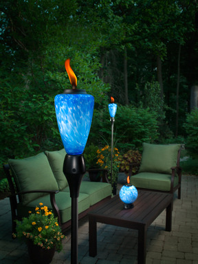 TIKI® Brand Glowing Torch contains multi-color LED lights that illuminate the decorative vessel from within.