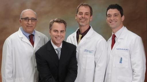 L to R: Behrooz A. Akbarnia, M.D. (lead surgeon); Ed Roschak, CEO of Ellipse Technologies; Assisting Surgeons Burt Yaszay, M.D. and Gregory Mundis, M.D.