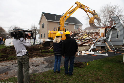 Homeowner Rita Gurry watches her house get bulldozed in Manasquan, NJ alongside Richard Trethewey, expert for THIS OLD HOUSE. Rita's house could not be saved and she decided to replace it with brand-new construction: a strong modular home.