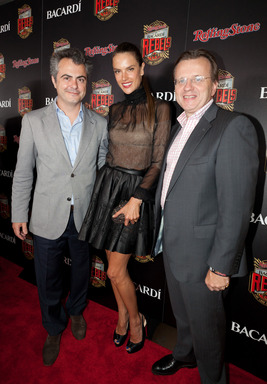 Alessandra Ambrosio poses with BACARDI Executives at the Rolling Stone hosted BACARDI Rebels Concert Event on Cuban Independence Day
