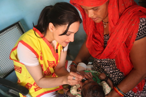 Actress and Rotary polio ambassador Archie Panjabi immunizes a child against polio in New Delhi, India.