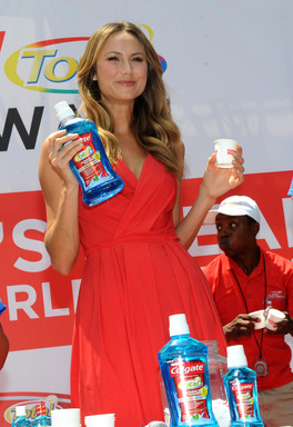 "Stacy Keibler ""swished"" for a difference at the Coglate® ""A Wish for a Swish"" event in New York while breaking the GUINNESS WORLD RECORDS® record for the ""Most people using mouthwash simultaneously""."