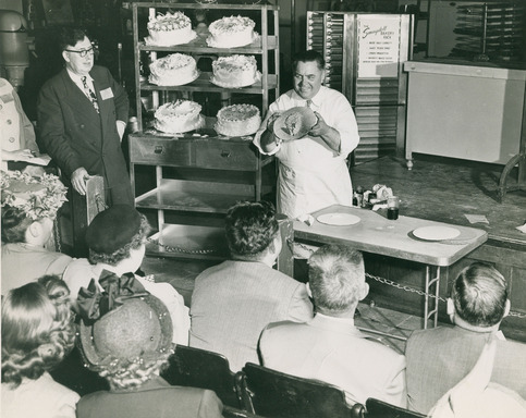 Dewey McKinley Wilton demonstrates a piping technique at The Wilton School of Cake Decorating on 63rd Street in Chicago in 1948