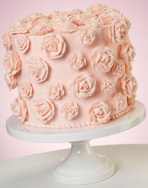Combining the classic Wilton Rose technique with trending buttercream creates a delicious peach cake.