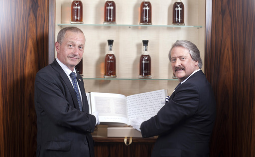 Richard Paterson and Nick Fleming, Head Wine and Spirits Buyer at Harrods, with Richard's hand crafted ledger