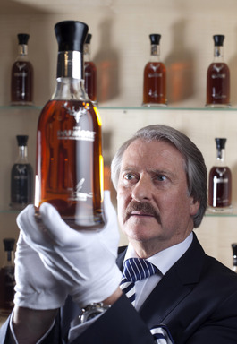 Richard Paterson inspecting a bottle from the Collection