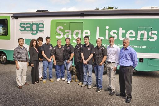 Family-owned RE Suspension, the first customer visited during the tour, greets the Sage team outside the RV