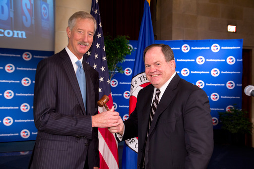 Amway Chairman and newly elected U.S. Chamber of Commerce Chairman Steve Van Andel (left) receives the chairman's gavel from outgoing Chamber Chairman Ed Rust at the June 19, 2013, board meeting.