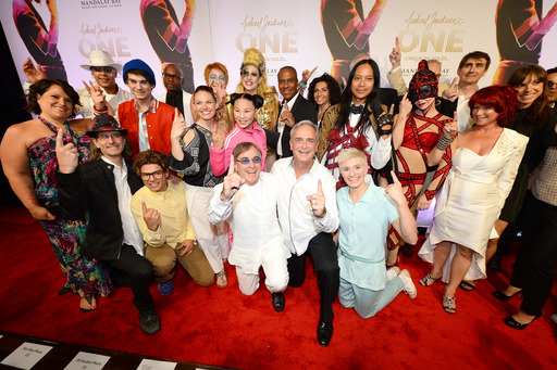 "Cirque du Soleil President & CEO Daniel Lamarre and Mandalay Bay President and COO Chuck Bowling pose with the cast at the world premiere of ""Michael Jackson ONE by Cirque du Soleil"" (Photo by Ethan Miller/Getty Images for Cirque du Soleil)NV - JUNE 29:"