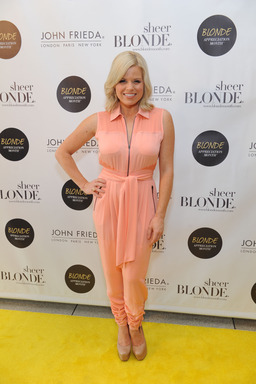Megan Hilty posing on John Frieda's  blonde carpet in honor of Blonde Appreciation Month