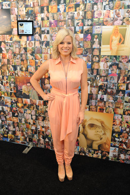 "Megan Hilty in front of John Frieda's exclusive ""everlasting"" art installation after unveiling the wall of curated images at The Time Warner Center"