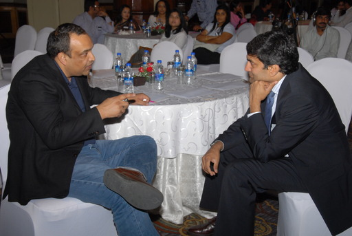 Post debate networking (l-r) Vinay Gupta, Ninan Chacko
