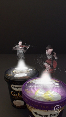A violinist and cellist play a Bach concerto duet atop cartons of Haagen-Dazs ice cream as part of the recently released Häagen-Dazs Concerto Timer mobile app.