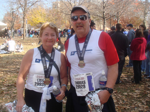 Tom Murphy with his former nurse and friend Lisa Smith after completing a half-marathon in 2012. Tom was diagnosed with stage 1A lung cancer through early detection CT scans and is now cancer free.