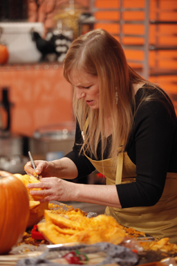 Halloween Wars Contestant carves a pumpkin on Food Network's Halloween Wars