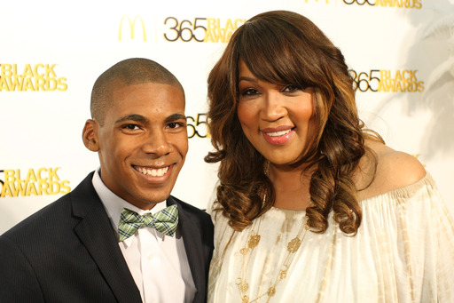 Golden carpet correspondent and actress/comedienne Kym Whitley poses with Influential Youth Award recipient Charles Orgbon, III at the 10th annual McDonald's® 365Black®  Awards.