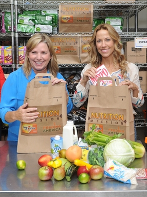 Sheryl Crow and One A Day Women's Nutrition Mission grant contest winner, Jeane Larkins volunteer at NYC's West Side Campaign Against Hunger to help feed Americans facing food insecurity.