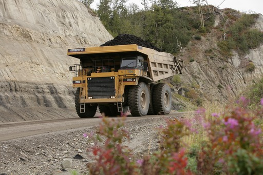 A 400-ton ore truck hauls coal to its destination.