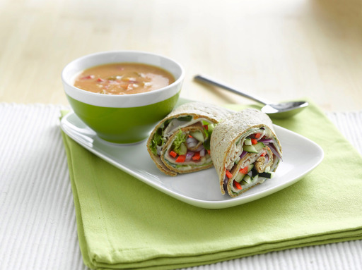 Peach yogurt and Dijon mustard are the special ingredients that make this turkey vegetable wrap taste great! Serve a half wrap with soup for a healthy 5-point meal.