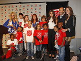 Selena hanging out with some of the children from The Salvation Army Arlington Corps during the press conference.