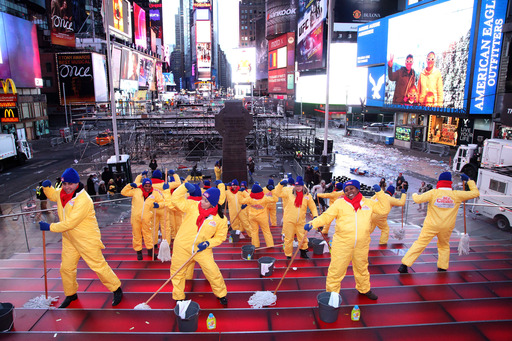 Times Square's red stairs get scrubbed with Mr. Clean Liquid Muscle after New Year's Eve on January 1, 2014 in New York City. (Photo by Rob Kim/Getty Images)