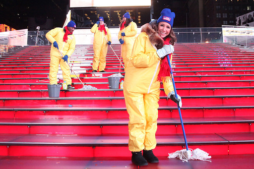 "Times Square gets scrubbed with Mr. Clean Liquid Muscle by ""The Accidental Housewife"" Julie Edelman and a cleaning crew after New Year's Eve on Jan. 1, 2014 in NYC.  (Photo by Rob Kim/Getty Images)"