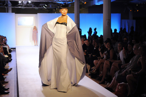Model Irina Pantaeva at the Malan Breton STYLE360 show. The gown, which featured a 17-foot-long train, was one of four looks in his collection inspired by the Fancy Feast cat.