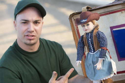 "Guns A-Blazin' Ep. - Mark ""The Hustler"" Meyer checks out a cowgirl doll he found among his winnings from the auction"