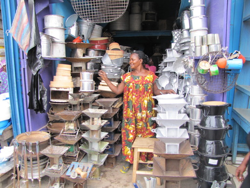 A woman sells cookstoves in her store in Ghana. Photo credit: Global Alliance for Clean Cookstoves
