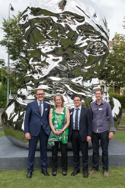 Inauguration of the Louis Chevrolet sculpture in La Chaux-de-Fonds: Dr. Thomas Sedran, President and Managing Director of Chevrolet Europe; Friederike Schmid, project curator; Théo Elie-Huguenin, City Councilor of La Chaux-de-Fonds; and Christian Gonzenba