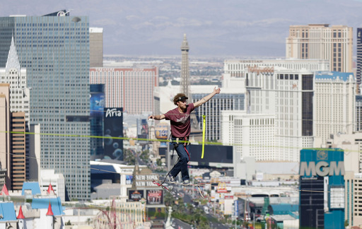 Andy Lewis balances moments before breaking urban highline world record at Mandalay Bay and House of Blues Foundation Room on October 16, 2013 in Las Vegas, Nevada.(Photo by Isaac Brekken/WireImage)